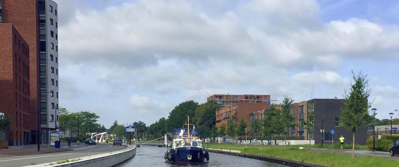 Appartement Huren in Mercuriushof kijkt uit over het kanaal
